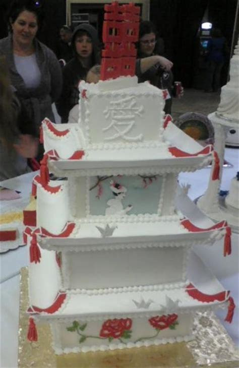 Pagoda style four tier wedding cake with Chinese character