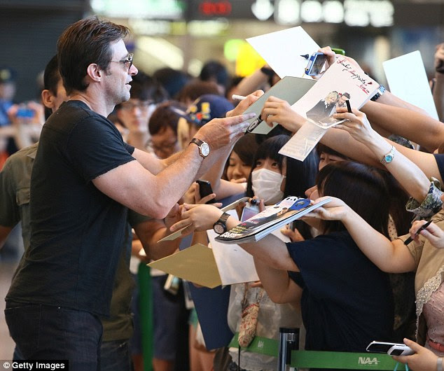 Mobbed: The movie star has been rushed by eager fans wherever he goes during his Japanese stop-off