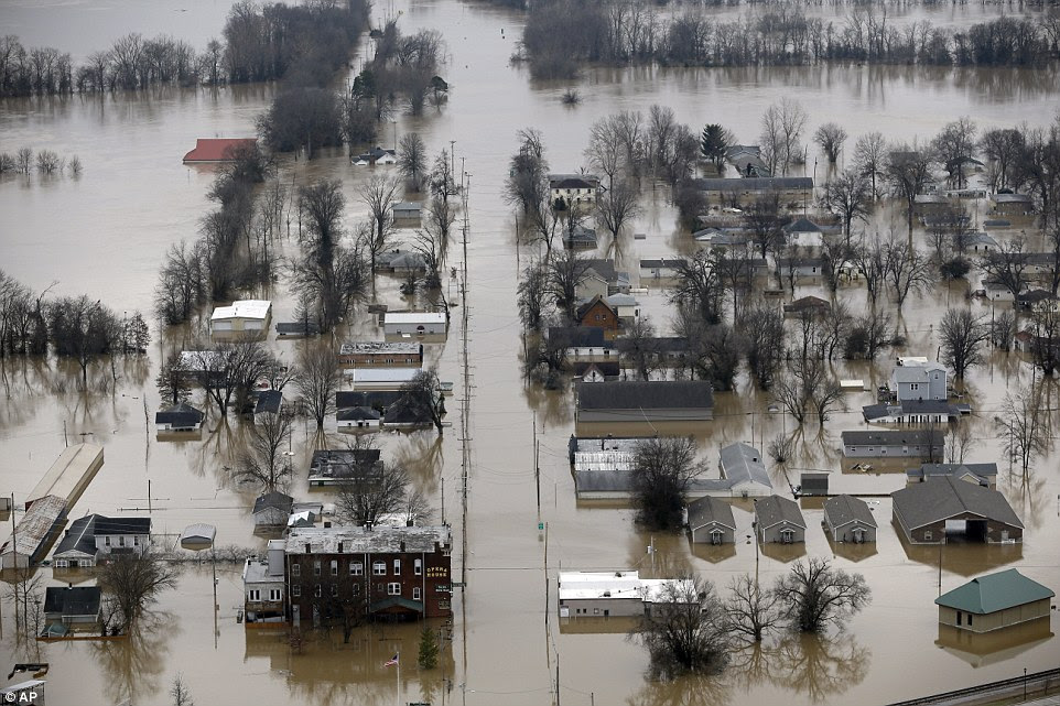 Missouri's governor activated the National Guard to help divert traffic from submerged roads, and torrential rain caused sewage to flow unfiltered into waterways. Pictured, Pacific, Missouri