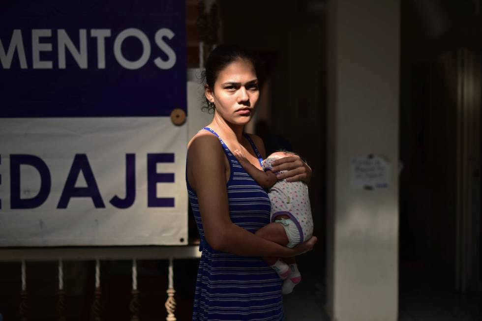 Elaine Miranda and her baby, stuck in Mexico.