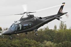 G-ZIPE - 2011 build Agusta A109E, departing a grey, damp Barton