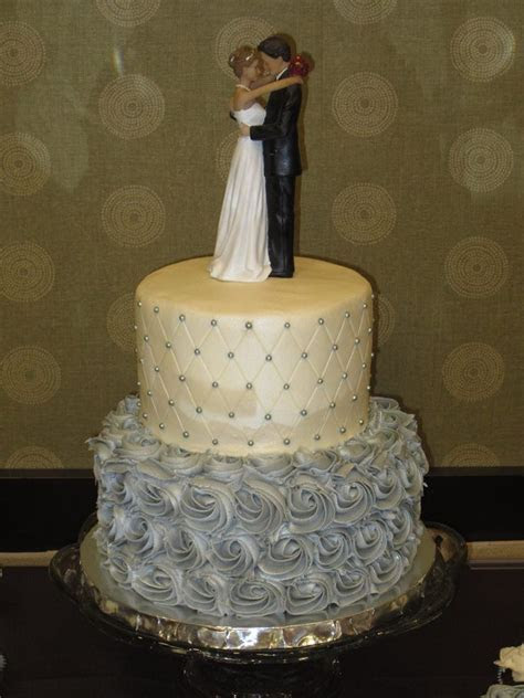2 tier silver and white wedding cake with silver