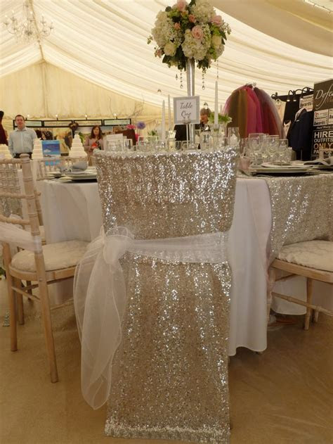 White organza sash over silver sequin chair veil by Simply