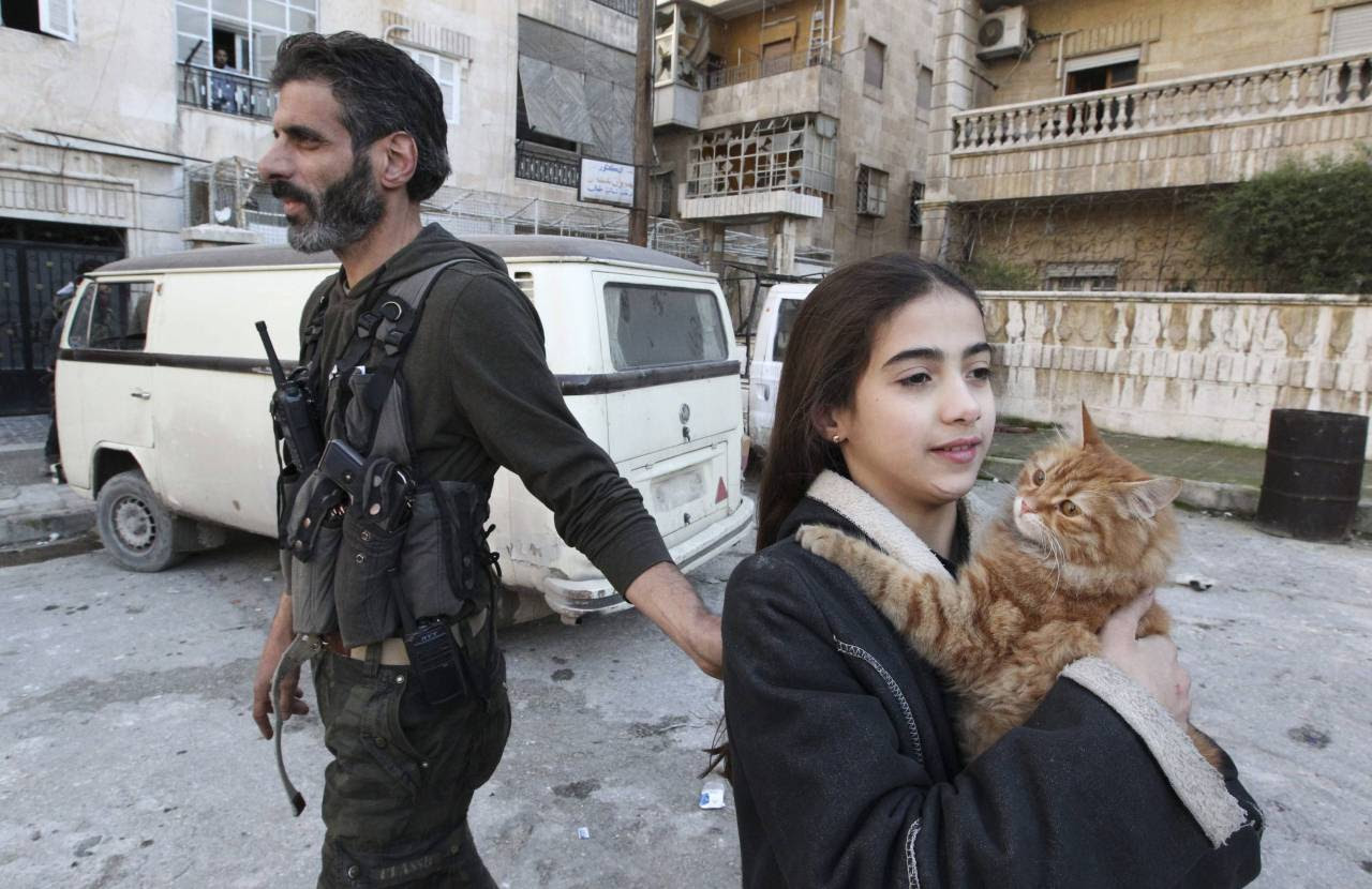 FSA fighter standing next to his daughter.