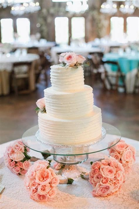 wedding cake display, bridesmaids bouquets under table. It