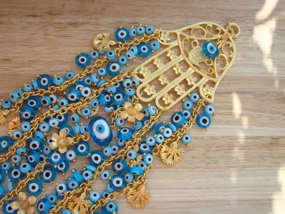 Hey, I found this really awesome Etsy listing at https://www.etsy.com/listing/169560564/evil-eye-beaded-gold-hamsa-wallhanging