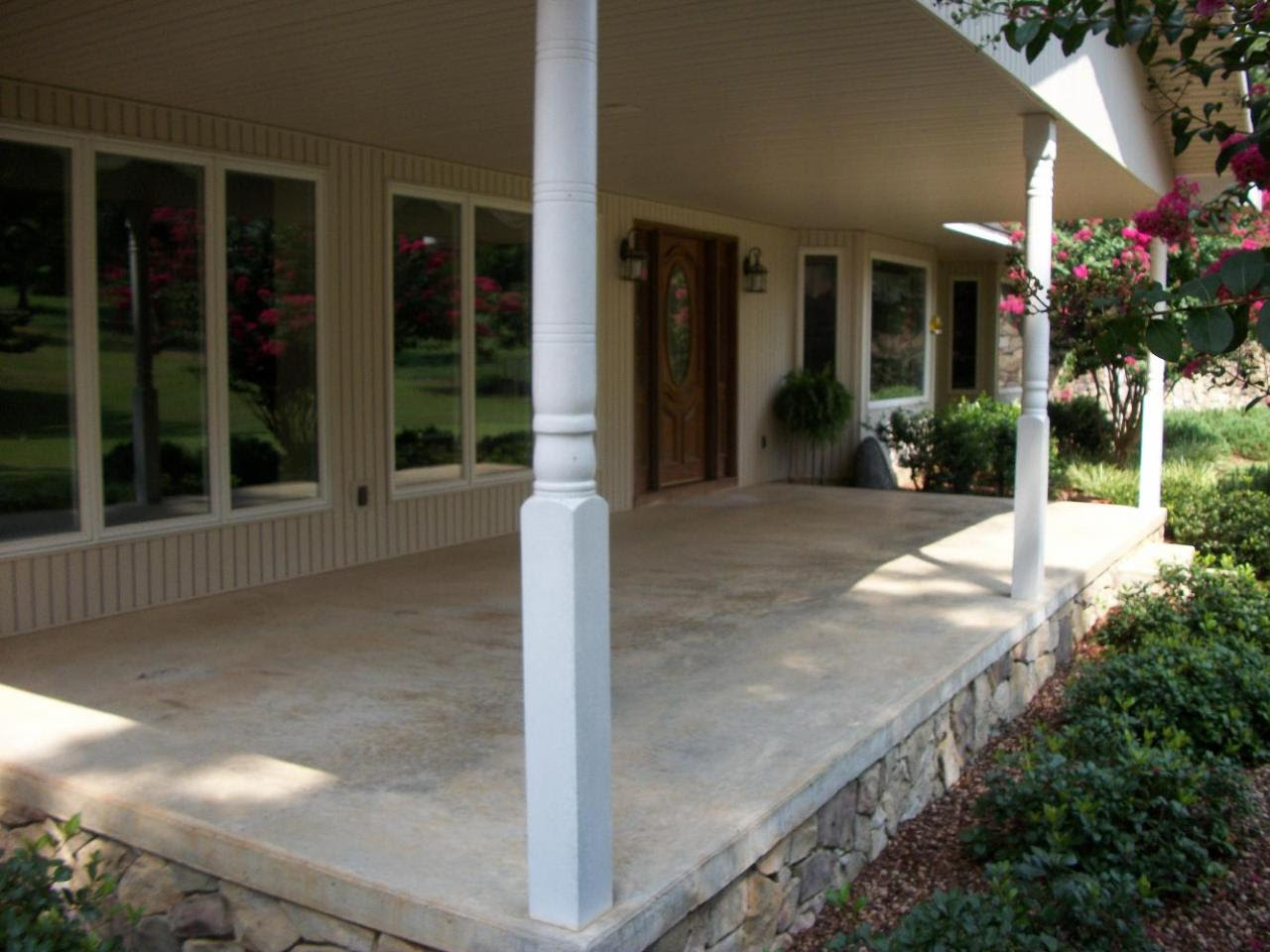 exterior chic cream color stone floor and cream wall paint color also brown wooden door with deck construction and front porch remodel inspiring front porch design ideas