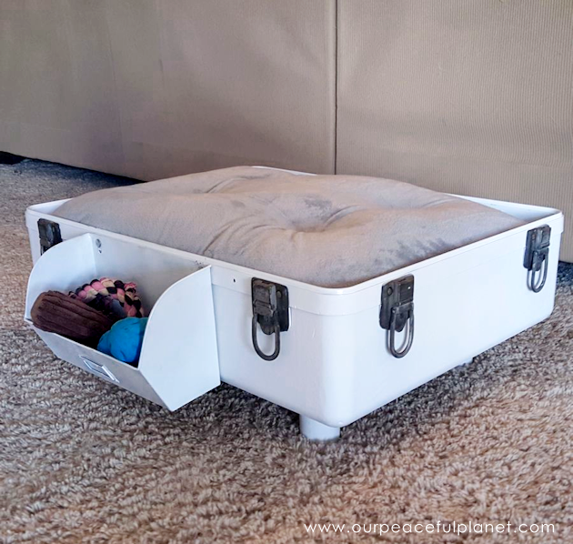 A suitcase makes the best DIY dog bed! You can style it however you like and we even show you how to attach a toy bin to the side. Your pup will love it!