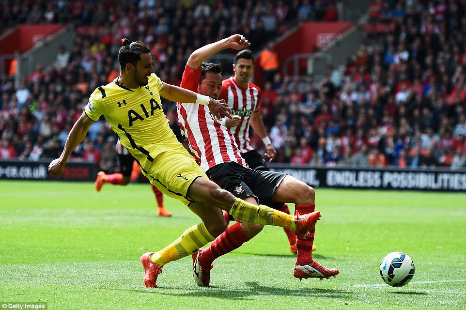 Chadli holds off Maya Yoshida before sliding the ball across the goal and into the bottom corner to earn the visitors a point