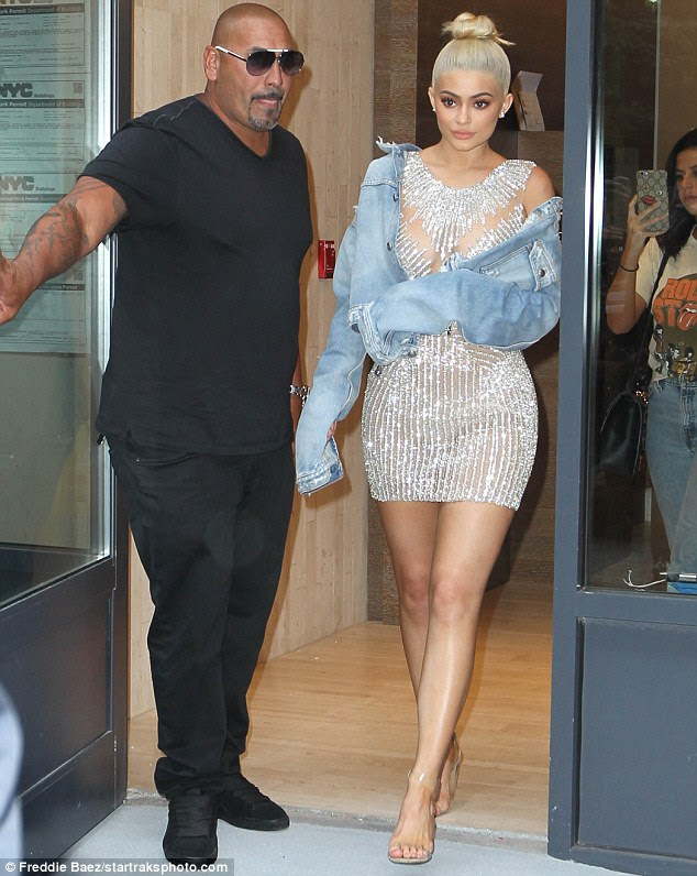 Good jeans: Kylie threw on a denim jacket but let it fall off her shoulders