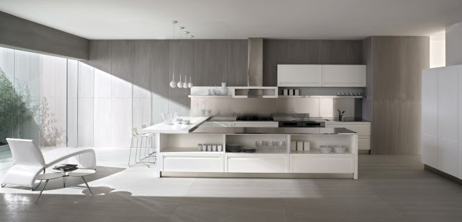 An ice white layout gives a clean visual, and these handleless cupboards work towards a sleek, fuss-free finish.