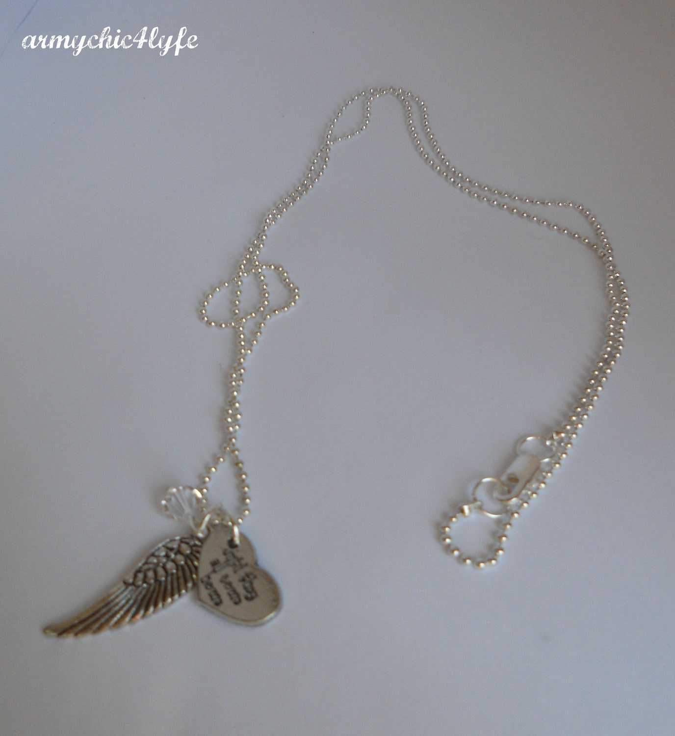Until They All Come Home Wing necklace with crystallized swarovski