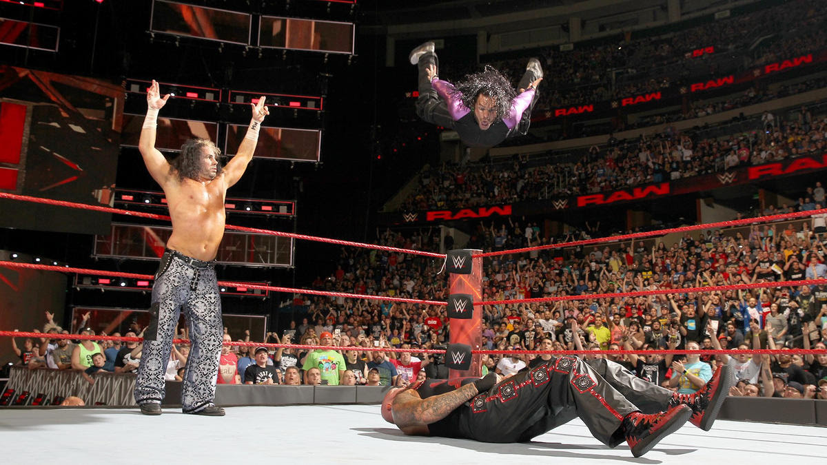 The Charismatic Enigma goes sky-high to hit the Swanton Bomb for the victory.