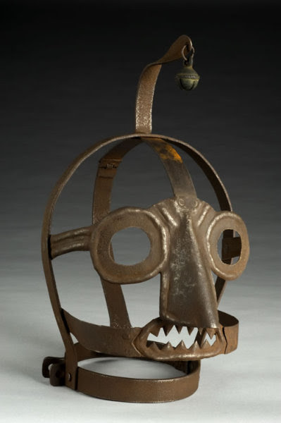 """That's the """"Scold's Bridle,"""" a gruesome mask used as punishment for  """"rude, clamorous woman,"""" who are considered to be spending too much  gossiping or quarreling in the Medieval times. It came complete with a  bell on top, no less:  Time spent in the bridle was normally allocated as a  punishment by a local magistrate. The custom developed in Britain in the  1500s, and spread to some other European countries, including Germany.  When wearing the mask it was impossible to speak. This example has a  bell on top to draw even more attention to the wearer, increasing their  humiliation. It was used until the early 1800s as a punishment in  workhouses."""