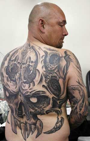 Permanent: a tattoo takes flight under expert hands.