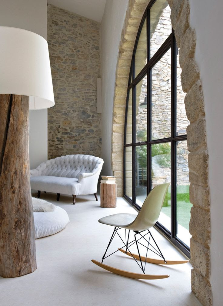 Stone arch and stonewall featured in this interior environment provides earthy elements that gives a safe feel to your space.