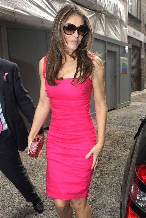 Liz Hurley deals with break up from Shane Warne at a