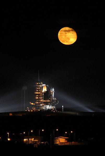The full moon shines bright high above space shuttle Endeavour as it prepares to launch towards the International Space Station on November 14, 2008.