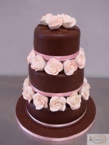 3 tier chocolate wedding cake with pink roses   La Creme