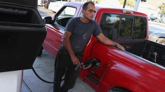 A customer puts gas into a vehicle at the U-gas station gas prices continue to drop in Miami, Florida.