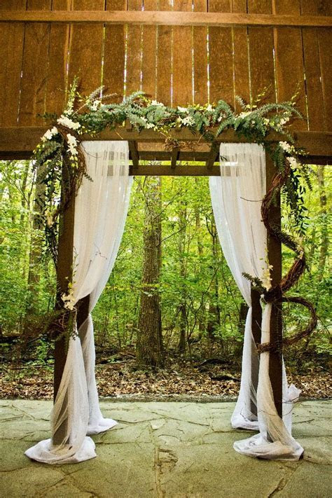 diy wedding arbor decor   Different flower arrangement