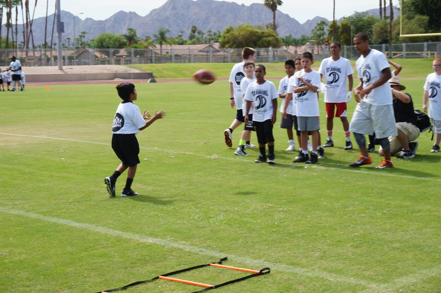 NFL and Palm Desert Alumni Hold Free Youth Football Camp  Palm Springs News, Weather, Traffic