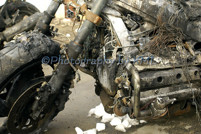 a motorcycle wreck in a salvage yard