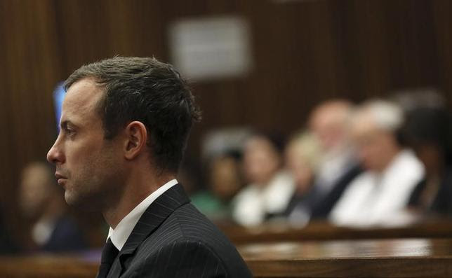 South African Olympic and Paralympic sprinter Oscar Pistorius sits in the dock before the defence's final argument in the North Gauteng High Court in Pretoria August 8, 2014. REUTERS/Themba Hadebe/Pool/Files