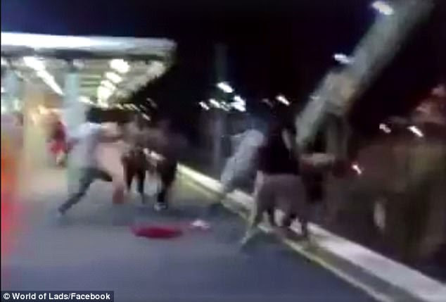 Men are pushed from the platform and thrown down onto the train tracks below in the sickening footage