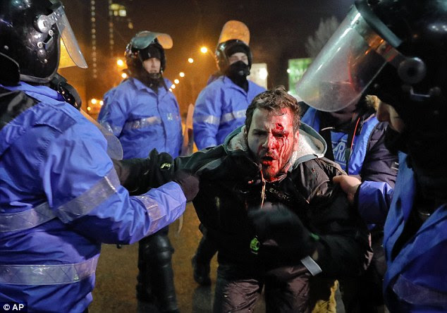 Romanian riot police detain a man after clashes erupted during a protest in Bucharest this week. But many fears the world is going to Hell in a handcart