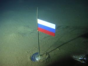 In this Thursday, Aug. 2, 2007, photo, a titanium capsule with the Russian flag is seen seconds after it was planted by the Mir-1 mini submarine on the Arctic Ocean seabed under the North Pole.