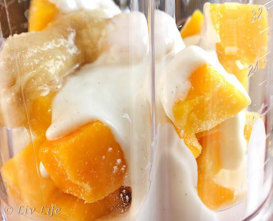 Orange Mango Smoothie ingredients in a KitchenAid Blender
