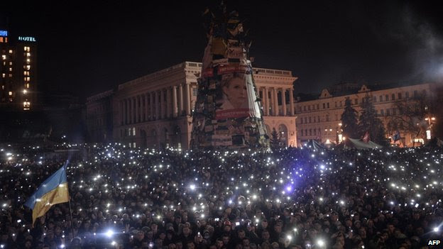 Anti-government protesters gather on the Independent square in Kiev on 21 February 2014.
