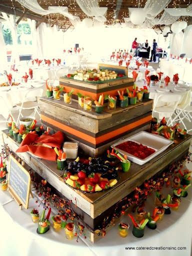 Mezze appetizer station on barnwood display.   Wedding