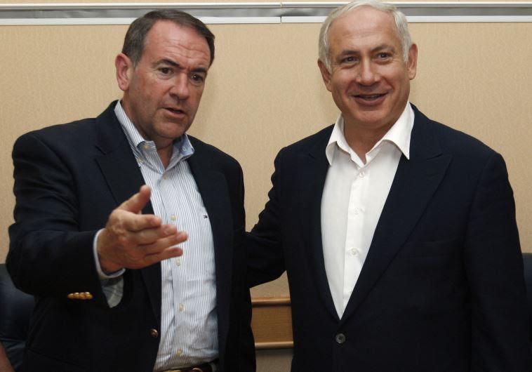 Former Arkansas Governor Mike Huckabee (L) meets Prime Minister Benjamin Netanyahu in Tel Aviv