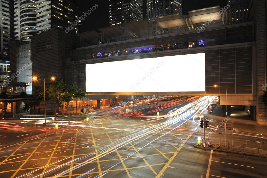 Big Empty Billboard at night in city with busy traffic — Stock ...