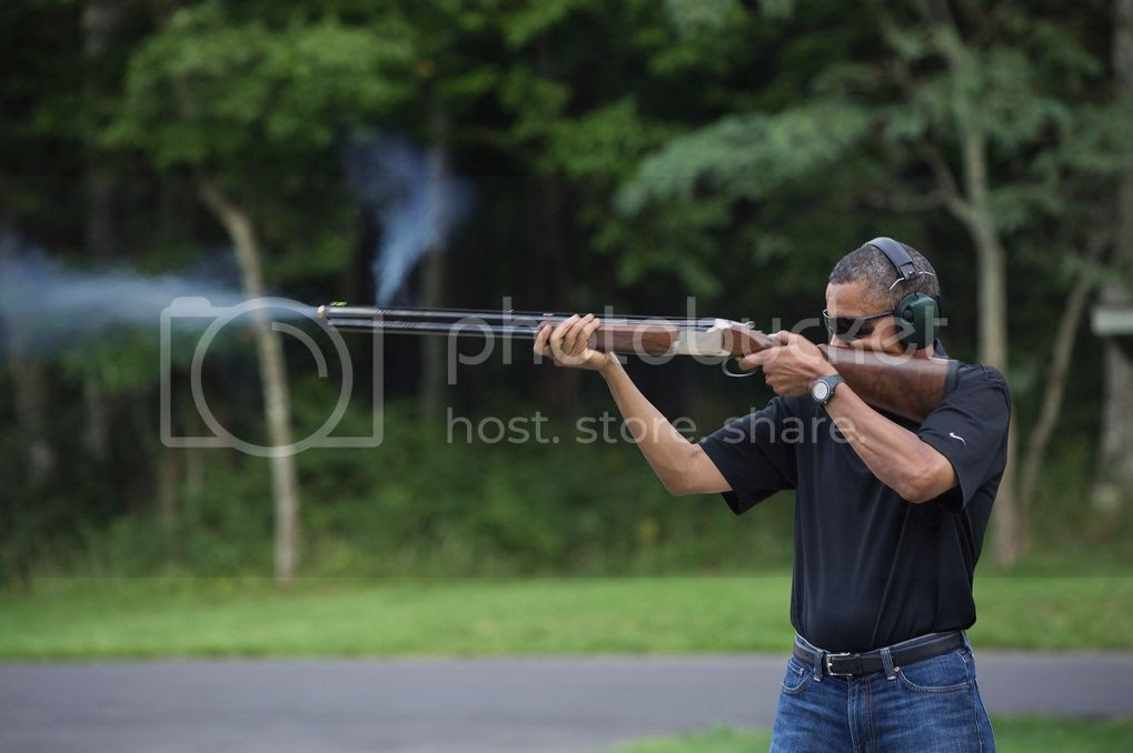 Obama shooting a gun, looking as bad-ass as ever