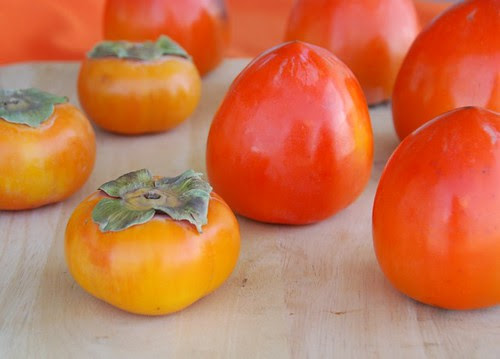 persimmons-- round Fuyus and heart-shaped Hachiyas