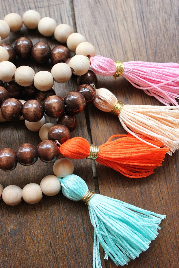 DIY: Wood Tassel Bracelets. Get your wood beads and supplies at www.fizzypops.com