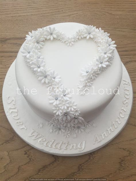 Gorgeous silver wedding anniversary cake decorated with