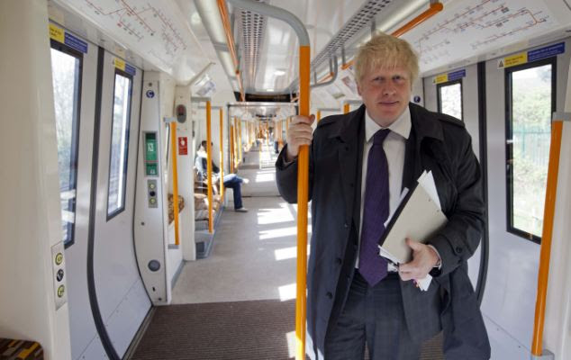 Future: Boris Johnson stands on a London Overground train, which could be used as the model for seatless economy class services