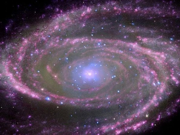 At the center of spiral galaxy M81 is a supermassive black hole about 70 million times more massive than our sun.