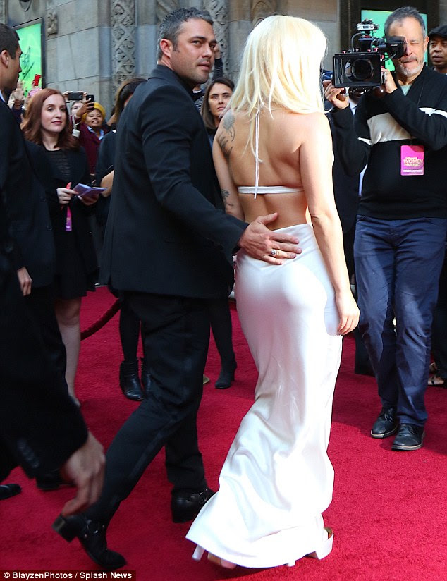Loved: The singer appeared to be in good spirits with her beau Taylor Kinney on her arm