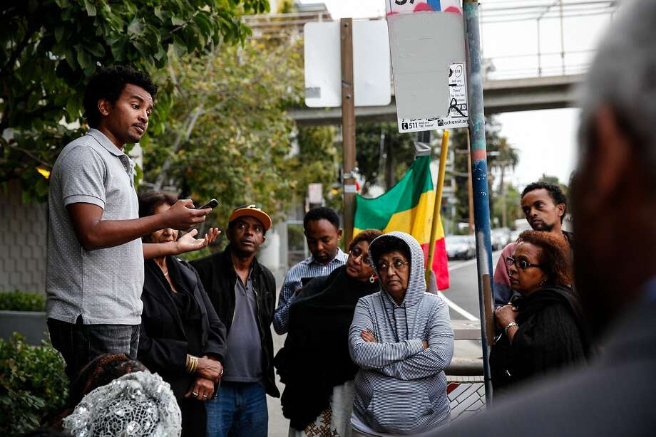 """Ash Gichamo speaks at a candlelight vigil in the spot where Yonas Alehegne, an Ethiopian immigrant, was shot and killed by an Oakland police officer in August, in Oakland, Calif., on Sunday, September 13, 2015.  Gichamo didn't know Alehegne but says there's a lot of Ethiopians in that neighborhood.  """"It could have been me,"""" he said. Photo: Sarah Rice, Special To The Chronicle"""