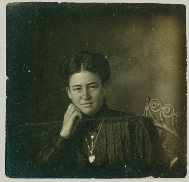 Woman and rattan chair and locket