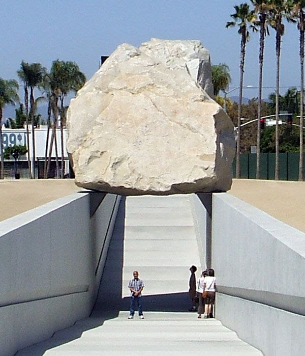 Posing for a photo beneath (err— sort of) 'Levitated Mass' on August 10, 2012.
