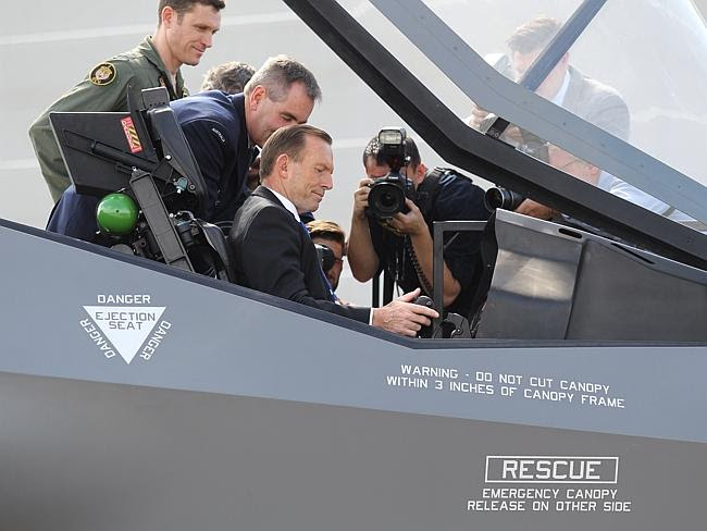 In case of emergency ... Prime Minister Tony Abbott inside the cockpit of an F-35 mock-up