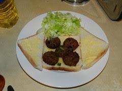 Bread, lettuce, white pudding - waiting for the omelette