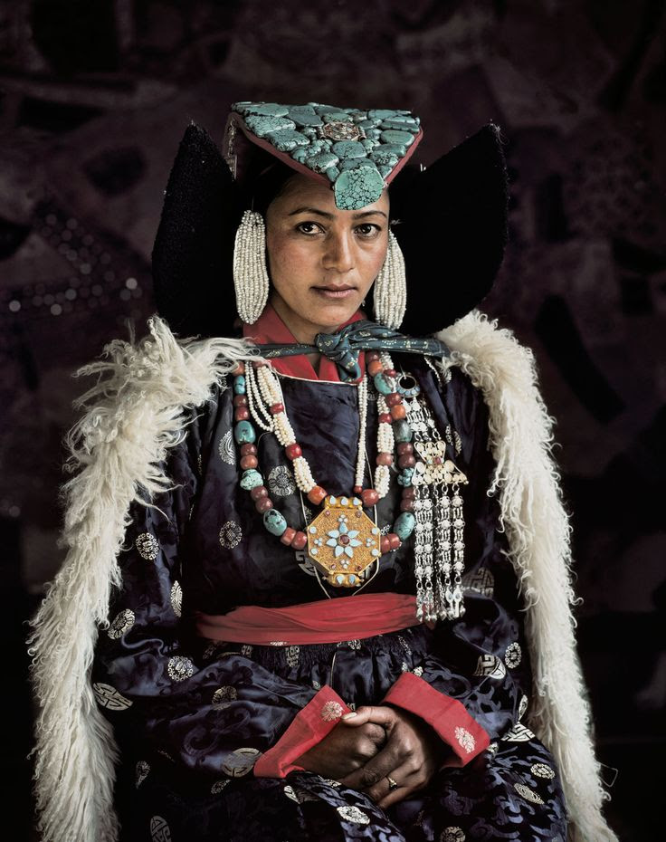 A Ladakhi woman in her traditional finery. Ladakh is a harsh, cold desert in Northern India.