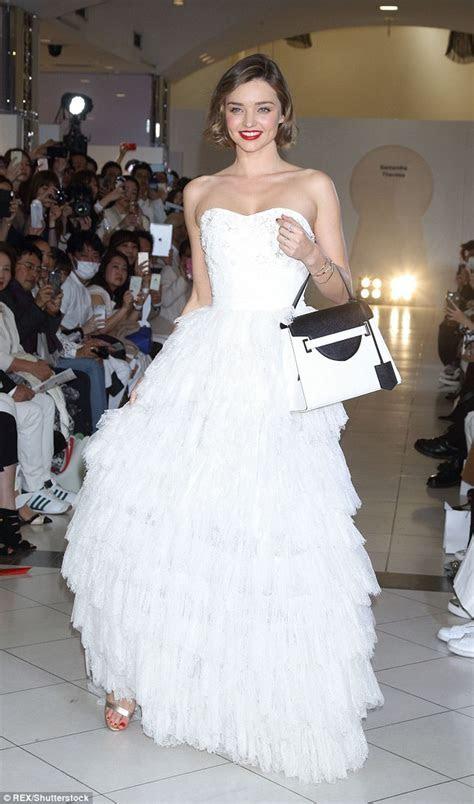 Miranda Kerr looks wonderful in white on the catwalk in